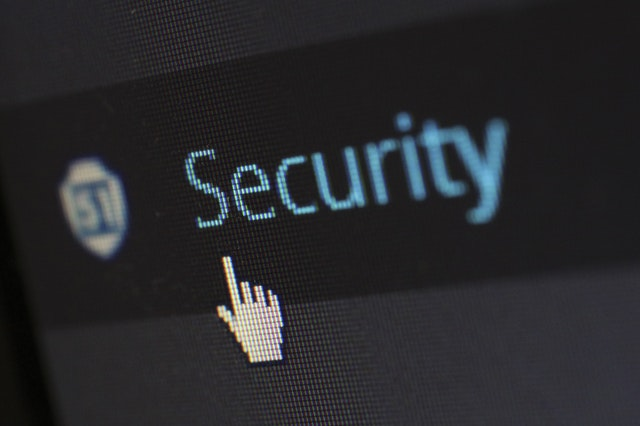 Section of computer screen with the mouse icon hovering above the security button